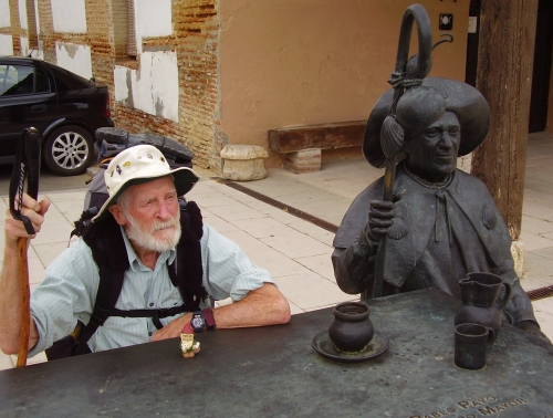 Des with pilgrim statue.